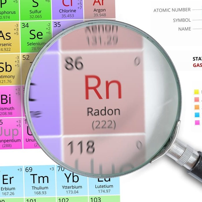 Radon - Element of Mendeleev Periodic table magnified with magnifying glass
